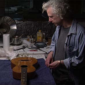 Gary Southwell restoring guitar played by James Joyce